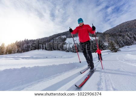 Cross-country skiing. Young man and woman doing outdoor exercise. Winter sport and healthy lifestyle.
