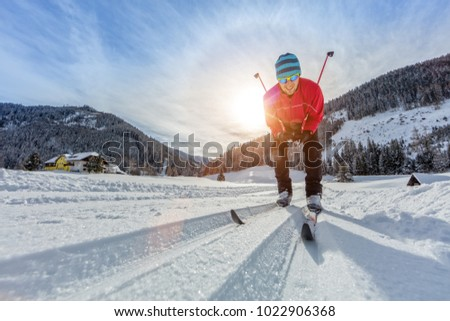 Cross-country skiing. Young man doing outdoor exercise. Winter sport and healthy lifestyle. #1022906368
