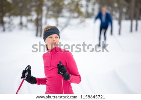 Cross-country skiing: young woman cross-country skiing on a winter day #1158645721