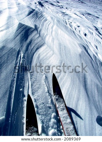 cross country skis on wind sculpted snow