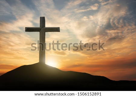 Photo of  cross crucifixion of the crucifixion of jesus christ on a mountain with a sunset background
