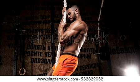 Cross fit athlete with a rope #532829032