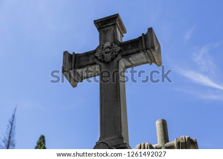 Cross in cementery, Madrid, Spain.