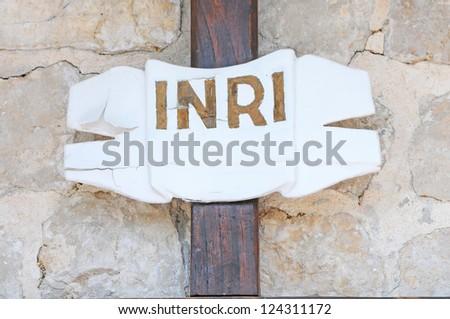 cross inscription on a stony background