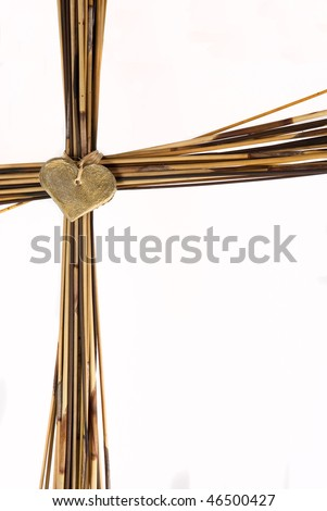Cross made from brown grass