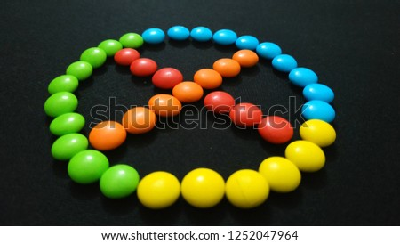 Cross Mark Sign or Symbol Using by Chocolate Gems #1252047964