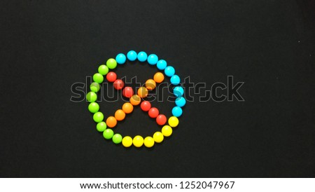 Cross Mark Sign or Symbol Using by Chocolate Gems #1252047967