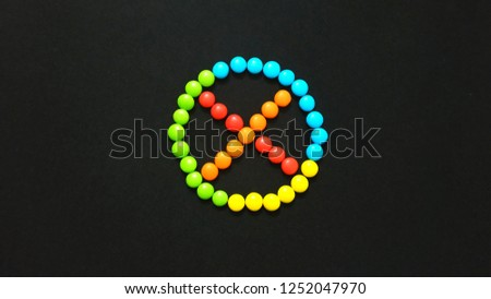 Cross Mark Sign or Symbol Using by Chocolate Gems #1252047970