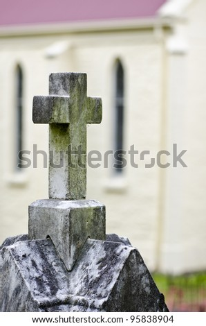 Cross on grave by door of church