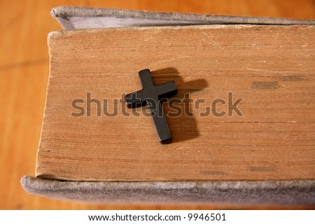 Cross on the old bible book