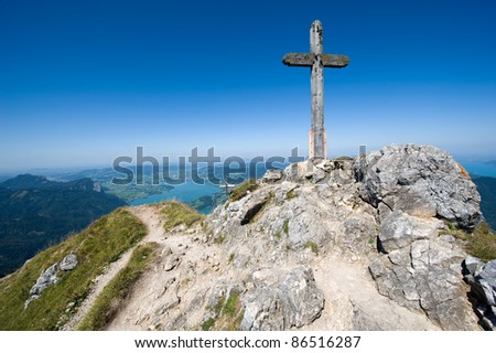 Cross on the top of the 1784 meters high mountain Schafberg in Austria