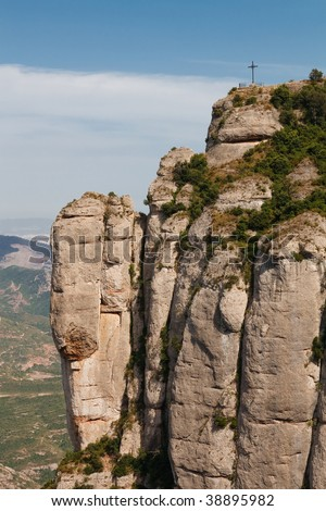 Cross on top of a cliff near the Montserrat Monastery, Catalonia, Spain