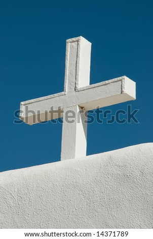 Cross on top of the wall surrounding the plaza of the St. Jerome Church, Taos Pueblo, New Mexico