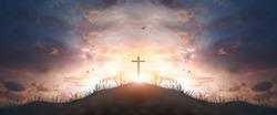 cross religion symbol silhouette in grass over sunset  sky cross religion symbol silhouette in grass over sunset or sunrise sky