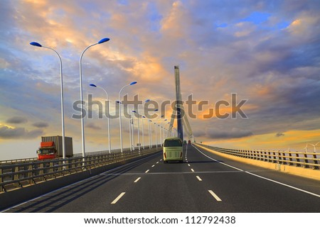 Cross sea bridge at sunset