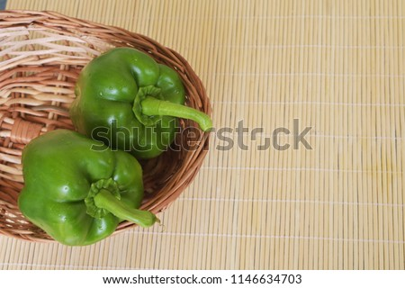Cross Section and sliced Green Capsicum on the wooden pot Royalty free Stock Photos and Images