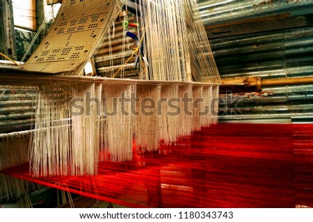 Cross section of a silk weaving machine (textile industry) with the threads attached taken in the silk weaving town of Sualkuchi, Assam,India