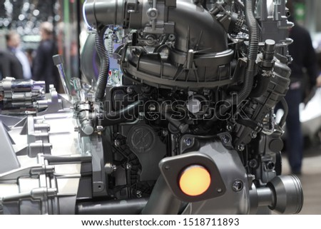 Cross-Section of motor showing us Compressor, turbocharger, fresh air intake and intake manifold at Autosalon Genf 2019 in Geneva, Switzerland