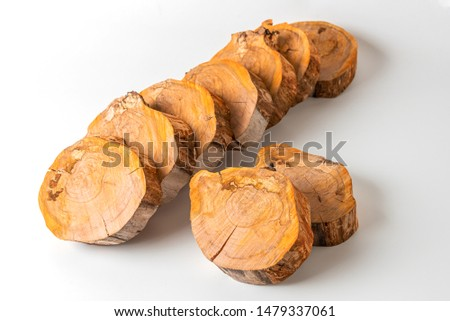 Cross sections of a tree trunk for design. Preparation of elements for decoration.