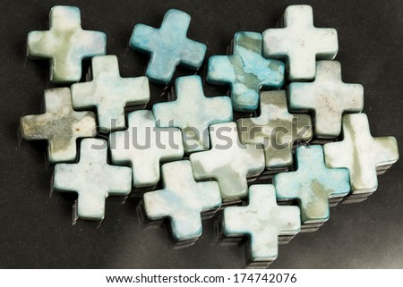 Cross shaped agate with dark background