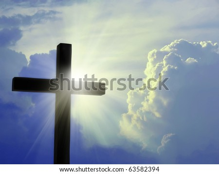 Cross silhouette against blue sky