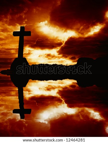 cross silhouette and the clouds at sunset, with reflection