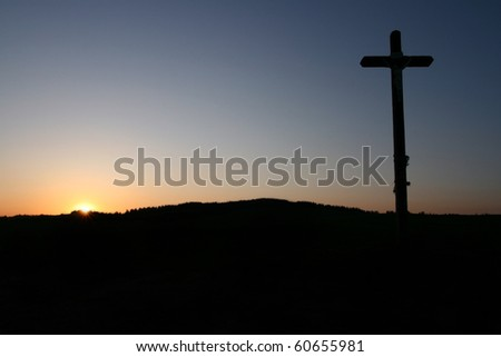 Cross silhouette at sunset