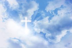 Cross silhouette in blue sky. Resurrection of Jesus