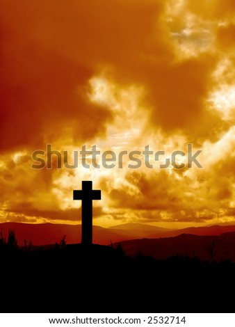 Cross  silhouette in high mountain against dramatical sky #2532714