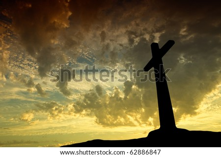 cross silhouette with the sunset as background