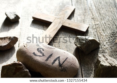 Cross sins and stones abstract easter confession religion background