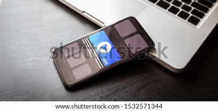Cross Targeting Programmatic Advertising audience ads concept illustration. Online native inbound advertising concept with smartphone and laptop on dark wood table
