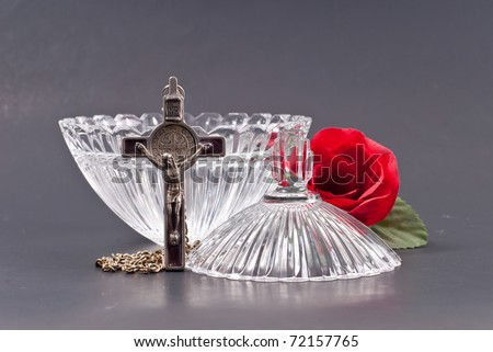 Cross with Crystal Dish Filled with Holy Water - stock photo