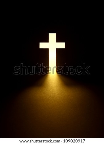 Cross with light shafts. Faith symbol.