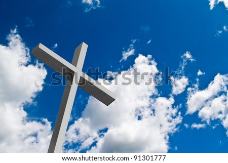 Cross with sunny blue sky and cloud