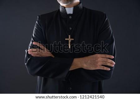 Crossed arms priest portrait senior male Stock fotó ©