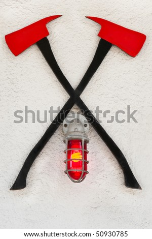 Crossed fire axes hanging in front of a fire station