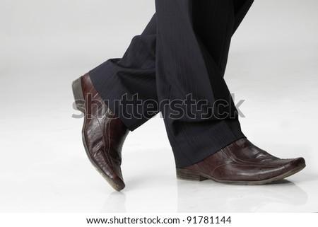 crossed legs of business man