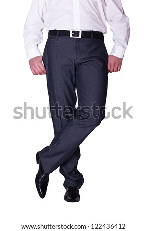 crossed legs of business man in pants and shoes