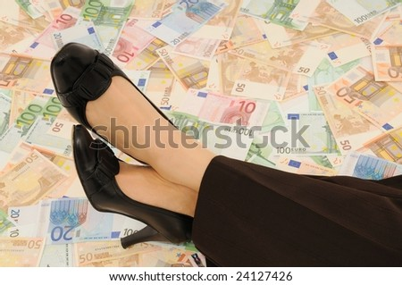 Crossed legs on banknotes (money under control and security concepts)