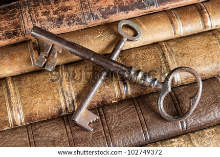 Crossed rusty keys on books symbolizing censorship