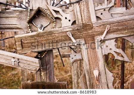 Crosses at the Hill of Crosses, located 12 kilometers north of the city of Siauliai, Lithuania. - stock photo