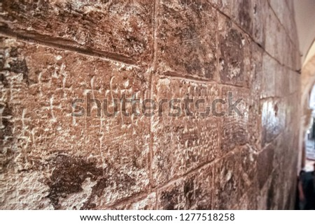 Crosses etched into the stone walls of the Church of the Holy Sepulcher, Jerusalem, Israel. Marking this the place of the burial of Jesus Christ. #1277518258