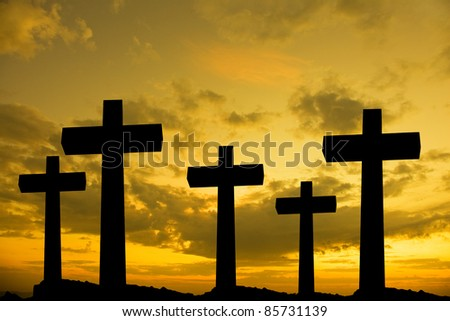 Crosses silhouette against the sky at sunset