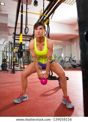 Crossfit fitness Kettlebells swing exercise woman workout at gym