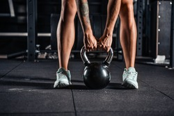 Crossfit kettlebell training in gym