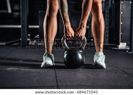 Crossfit kettlebell training in gym Stock photo ©