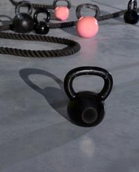 Crossfit Kettlebells ropes  in fitness gym floor