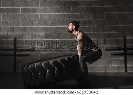 crossfit training - man flipping tire Stock photo ©