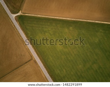 Crossing of country road and dirt road from above #1482291899